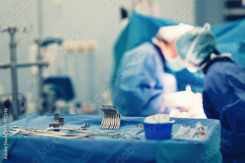 Surgical nurse pick up sterile instrument in the surgery operation