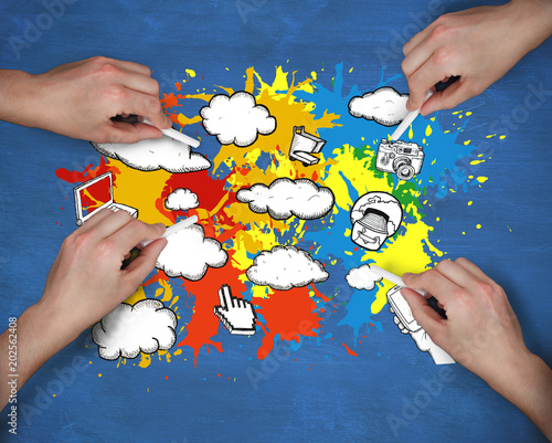 Composite image of multiple hands drawing apps with chalk against