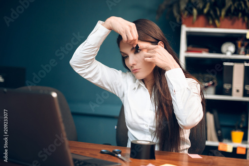 Bored lady trying to stay awake in her office Crazy female office