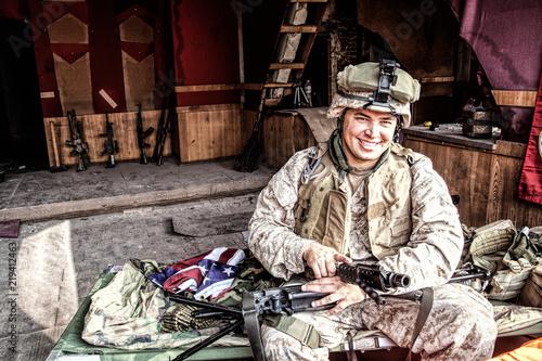 Marine Corps machine gunner smiling, disassembling, making