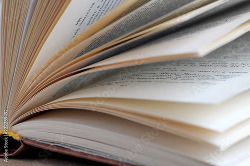 Book pages open book on a beige background Library and literature