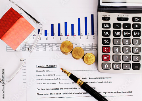 pen and calculator on mortgage loan application form backgrounds