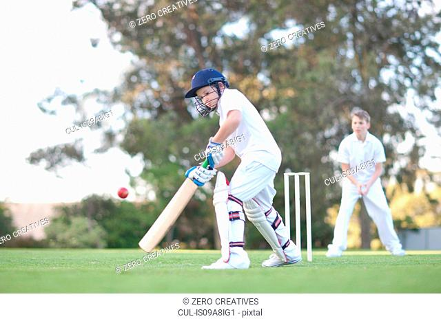 Boy playing cricket Stock Photos and Images age fotostock