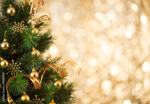 Christmas tree background with gold blurred light\