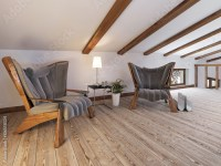 """""""The attic floor with a seating area with designer chairs ..."""