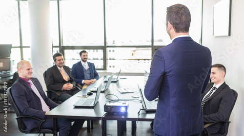Successful team leader and business owner leading informal in-house