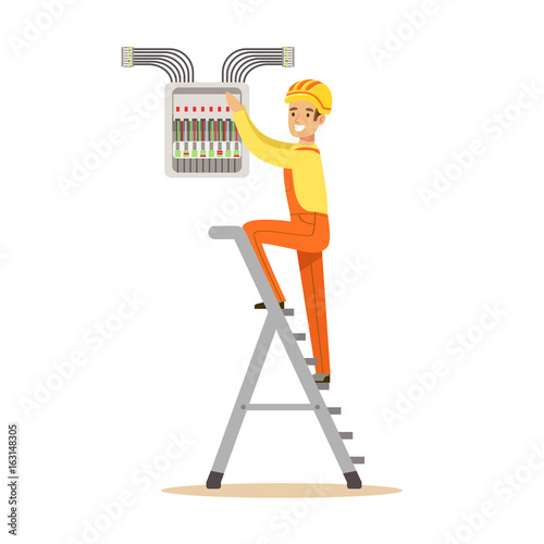Electrician standing on a stepladder and screwing equipment in fuse