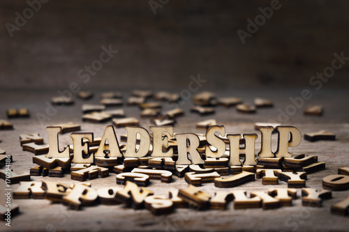 Wood Alphabets form a Word Placed on Scattered Alphabets for - word alphabets