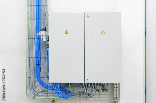 electricity distribution box with wires and circuit breakers (fuse