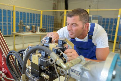 industrial mechanic fixing a machine\