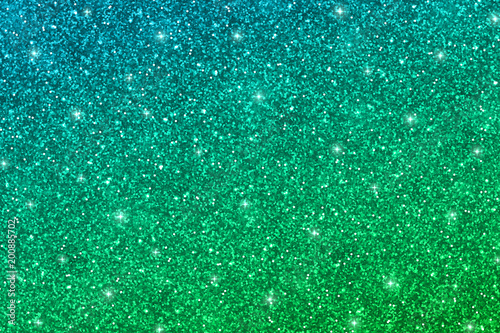 Glitter texture with blue green gradient\