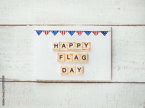Card with a pattern of the US Flag and words of congratulations on