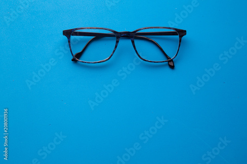 graduated glasses on blue background\