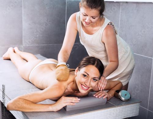 female massage therapist massaging woman\