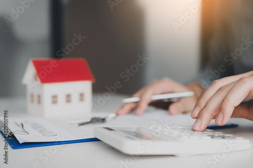 Close up of finger businessman using calculator calculate budget