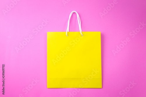 yellow shopping bag one pink background and copy space for plain
