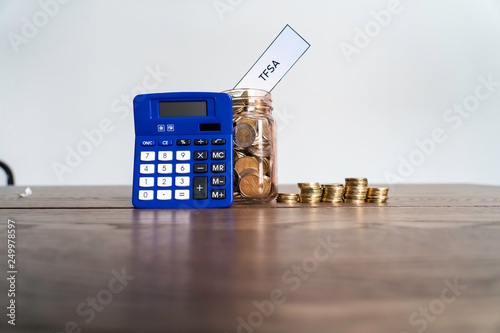 Jar of Coins with calculator showing savings to a Tax Free Savings