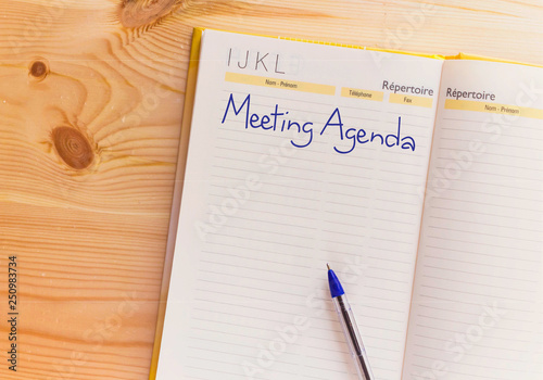 Writing text showing Meeting Agenda Business concept\