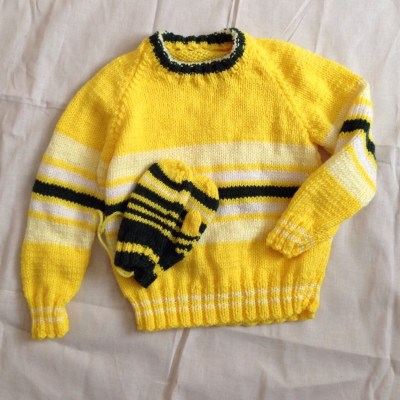 handknitted striped sweater and mittens