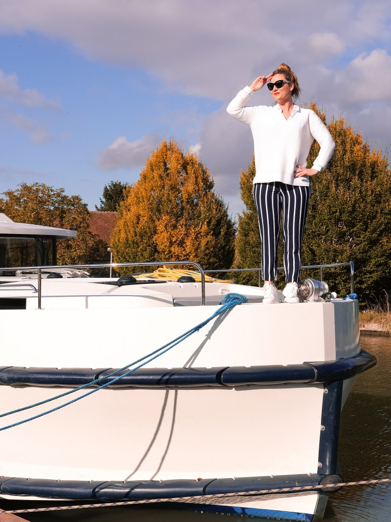 striped trousers white sweater