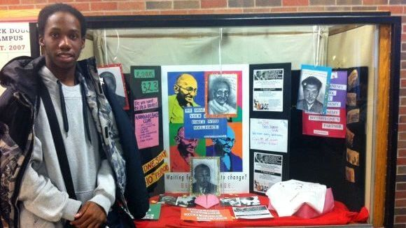 Dennis Smith in front of Non-Violent Club display case at Douglass