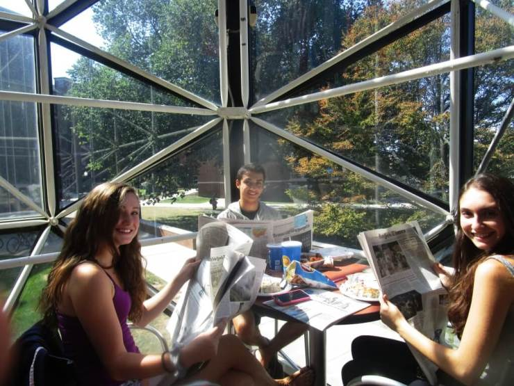 First year students (l-r) Molly Fultz (Brighton), Jake Forman (Westchester County) and Gabriella Wahba (Brazil) start every morning with the newspaper. Actually, Gabriella says in Brazil print newspapers and magazines are still popular and daily home delivery is common. Wilson Commons 9/13/16