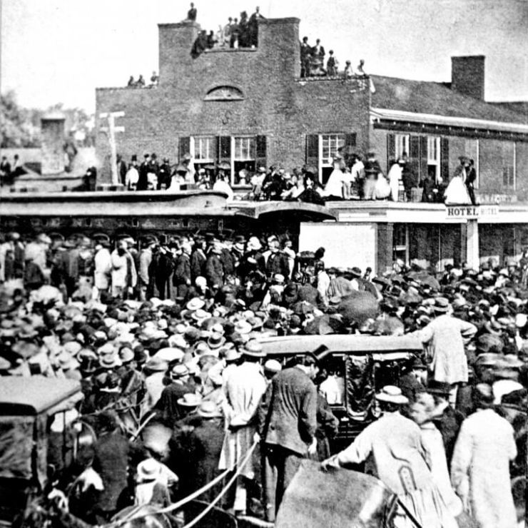 President Johnson (man on platform facing left) spent 15 minutes in Geneva in 1866; his railroad car stopped next to the Tompkins House on the northwest corner of Lewis and Exchange streets.