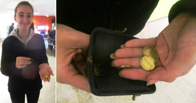 Audrey with Anya's luck found money coin purse at the National Museum of Play. [Photos: David Kramer]