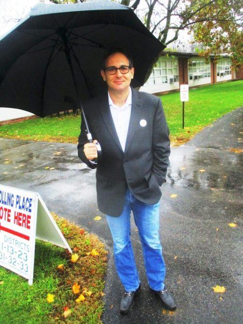 Braving the rain on Election Day. This man voted for the Reform Party presidential candidate in the early 90s.