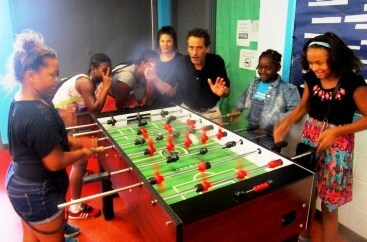 Dropped ball in motion. Foosball and art at the Edgerton-R Center. 8/24/16 [Photo: Sherod Smith, staff member]