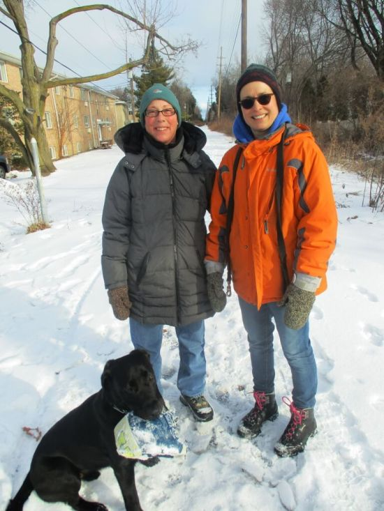 Trudy (left) and Katie, regular dog walkers on the Auburn Trail. Although they feel the Whole Foods project is too expansive, they were Trudy and Katie were pleased to learn the Auburn Trail improvements would include their favorite stretch. [Photo: David Kramer, 2/16/19]