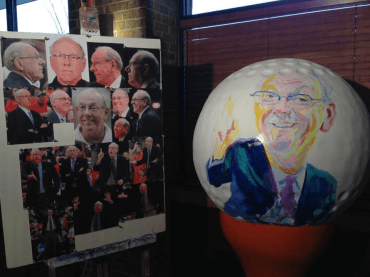 A 3-foot-tall Jim Boeheim golf ball created by Rolling Stone magazine sketch artist Philip Burke as part of Golf Balls on Parade (2012)