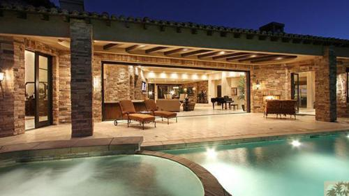 Kyle and Mauricio's gorgeous new Palm Springs home. Pocket doors open the home to the large patio.
