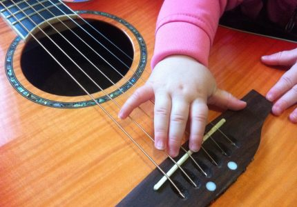 Taliah's Hand on My Acoustic Guitar