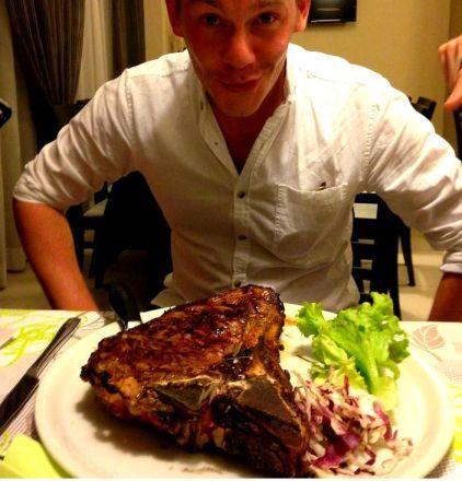 Man and meat. Bistecca Fiorentina