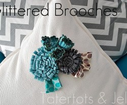 Glittered Brooches on pillows
