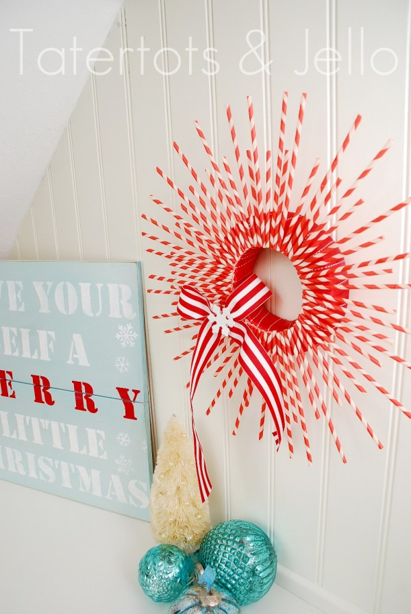 red and white paper straw christmas wreath