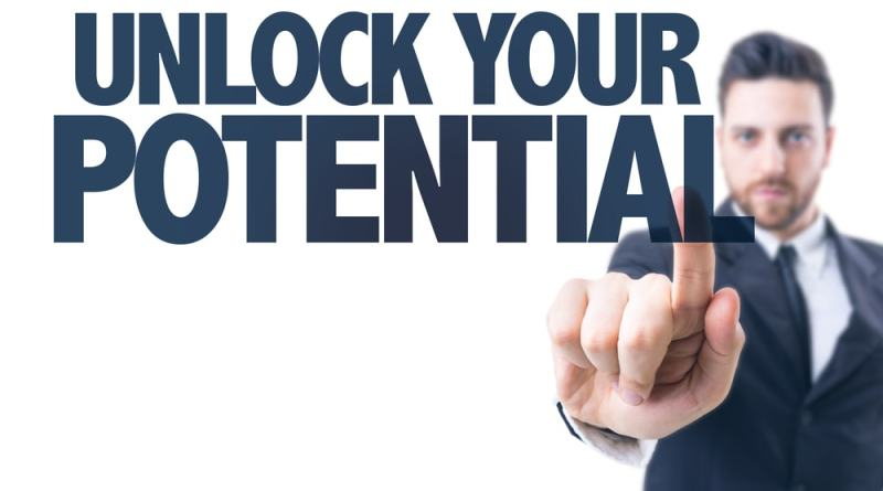 shutterstock_271790072 Business man pointing the text: Unlock Your Potential Leadership Interview Man Suit Beard