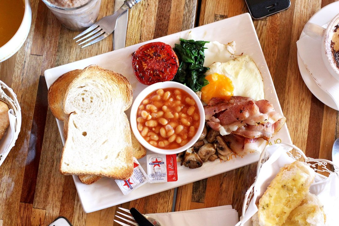 The Big Breakfast from Sweet Pumpkin Soup in Eastwood comes with baked beans, mushrooms, bacon, eggs, wilted spinach, grilled tomato half and thick slices of white toast.