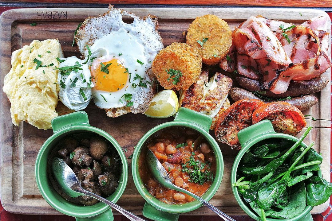 Poached, scrambled and fried eggs, toast and lebanese bread with sides of merguez sausage, bacon, roasted tomato, hash brown, grilled haloumi, mushrooms, baby spinach, and baked beans