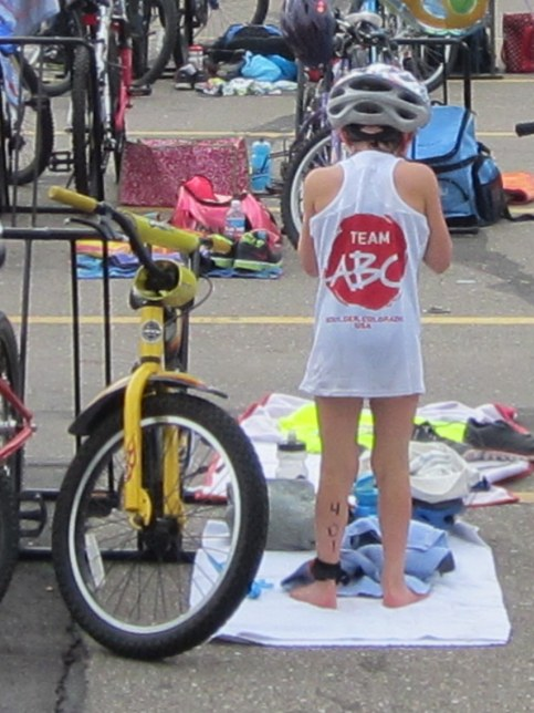 Rachel switching to her bike in the Longmont Youth Triathlon.