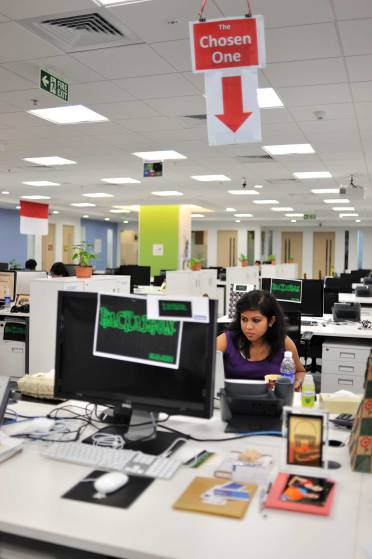 Indian and American employees work out of the Facebook offices in Hyderabad, India, December 1, 2010. The offices were recently opened in September 2010, and are presently hiring new employees. (Photograph by Lynsey Addario/Getty Images Reportage)