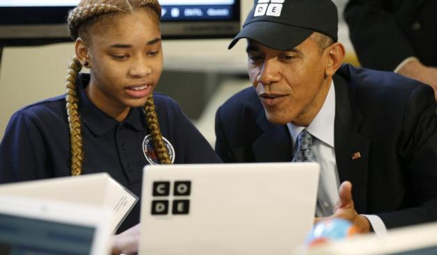 Picture of US President Barack Obama talking with a young girl about computer programming during the 2014 Hour of Code event.