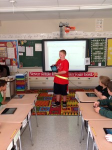 6th Grader Preston teaches a 5th grade class about iPads
