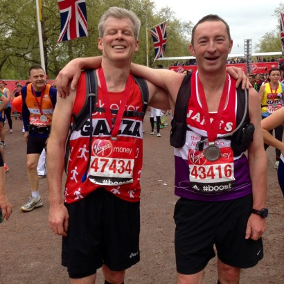 James (right), at the finish with Gary, the running partner who held him back so badly.
