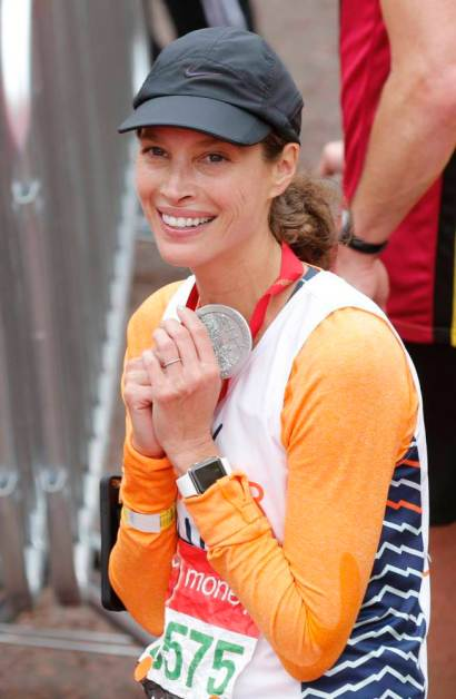 Athletics - Virgin Money London Marathon - London - 26/4/15 Christy Turlington Burns poses with her medal after finishing the Virgin Money London Marathon Reuters / Suzanne Plunkett Livepic
