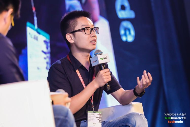 """Ofo's co-founder Austin Zhang speaking at a panel called """"How Does Sharing-economy Push the Development of Credit City?"""" at TechCrunch Shenzhen 2017."""