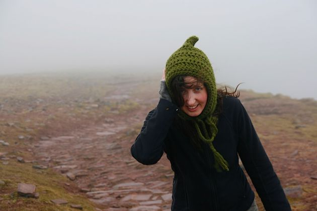 Katherine holding her ear on in the Brecon Beacons