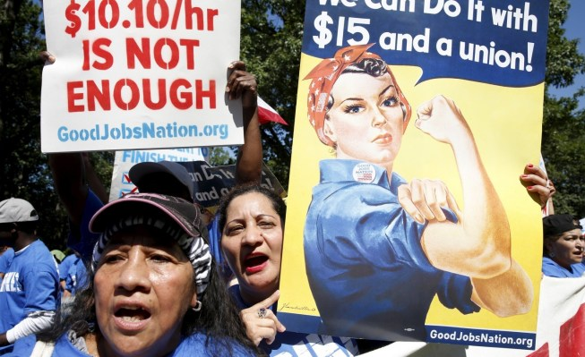 Protesters' fight for a $15 minimum wage has been a long one which is still going on across the nation. July 22, 2015. Photo by Kevin Lamarque.