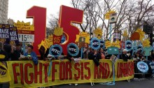 Protesters call for $15 minimum wage increases in New York, whose campaigning in DC gives a huge win to the minimum wage workers in the DC area. Photo from In These TImes.